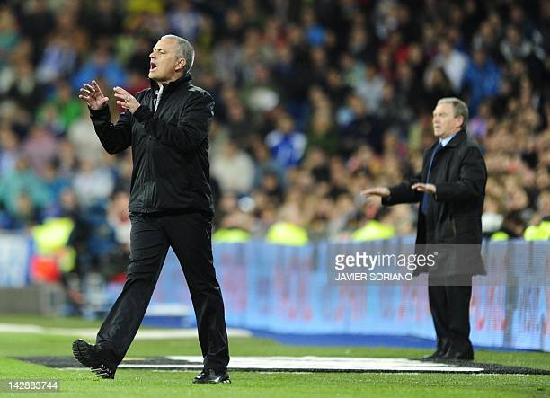 Real Madrid's Portuguese coach Jose Mourinho gestures in front of Sporting Gijon's coach Javier Clemente during the Spanish league football match...