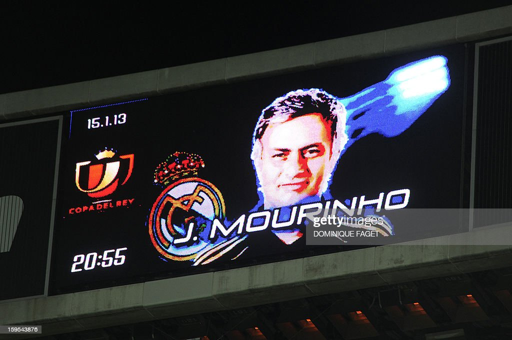 Real Madrid's Portuguese coach Jose Mourinho is displayed on the score board before the Spanish Copa del Rey (King's Cup) quarter-final football match Real Madrid CF vs Valencia CF at the Santiago Bernabeu Stadium in Madrid on January 15, 2013.