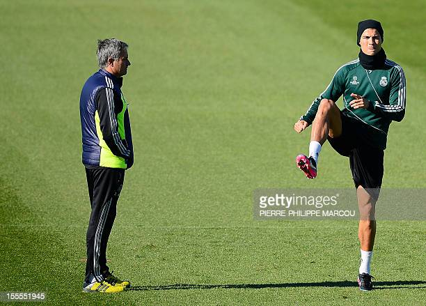 Real Madrid's Portuguese coach Jose Mourinho looks at Real Madrid's Portuguese forward Cristiano Ronaldo during a training session on November 5 2012...