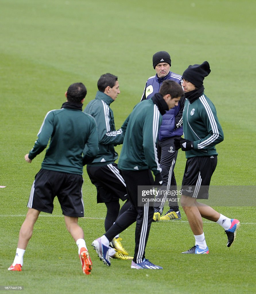 Real Madrid's Portuguese coach Jose Mourinho (2nd R) looks on as Real Madrid's players take part in a training session at the Valdebebas training ground in Madrid on April 29, 2013, on the eve of the UEFA Champions League football match Real Madrid CF vs Borussia Dortmund.