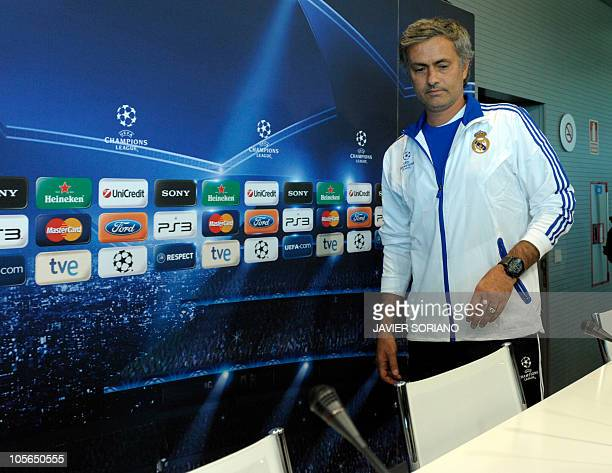 Real Madrid's Portuguese coach Jose Mourinho looks on during a press conference before a training session at Real Madrid's sport city on October 18...