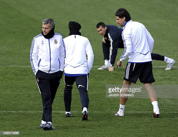 Real Madrid's Portuguese coach Jose Mourinho Real Madrid's German midfielder Mesut Ozil and Real Madrid's German midfielder Sami Khedira take part in...