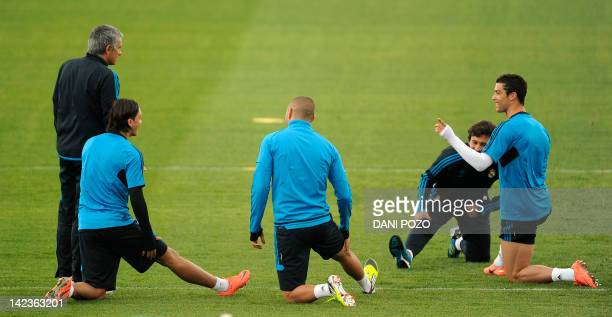Real Madrid's Portuguese coach Jose Mourinho Real Madrid's Portuguese forward Cristiano Ronaldo Real Madrid's French forward Karim Benzema and Real...