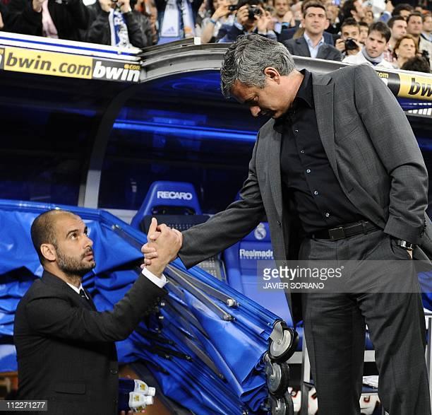 Real Madrid's Portuguese coach Jose Mourinho shakes hands with Barcelona's coach Josep Guardiola before ' El Clasico' Spanish League football match...
