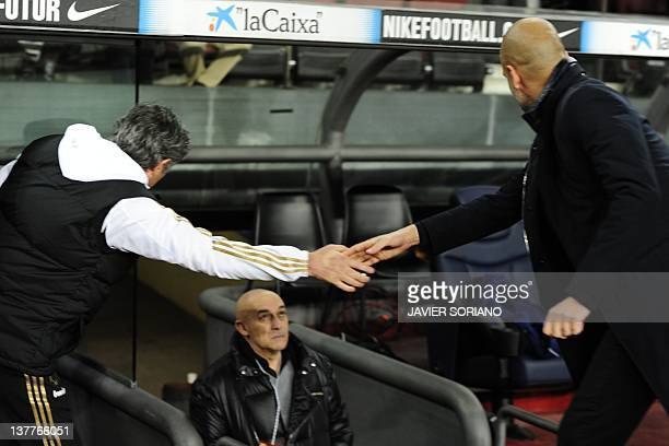 Real Madrid's Portuguese coach Jose Mourinho shakes hands with Barcelona's coach Josep Guardiola before the second leg of the Spanish Cup...