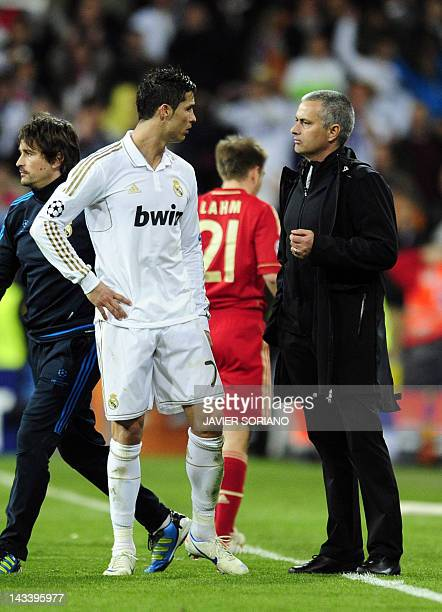 Real Madrid's Portuguese coach Jose Mourinho talks to Real Madrid's Portuguese forward Cristiano Ronaldo during the UEFA Champions League second leg...
