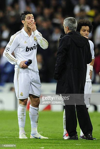 Real Madrid's Portuguese coach Jose Mourinho talks with Real Madrid's Portuguese forward Cristiano Ronaldo and Real Madrid's Brazilian defender...