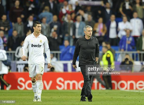 Real Madrid's Portuguese coach Jose Mourinho walks with Real Madrid's Portuguese forward Cristiano Ronaldo at the end of the UEFA Champions League...