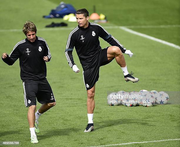 Real Madrid's Portuguese defender Fabio Coentrao and Real Madrid's Portuguese forward Cristiano Ronaldo train at Valdebebas Sport City in Madrid on...