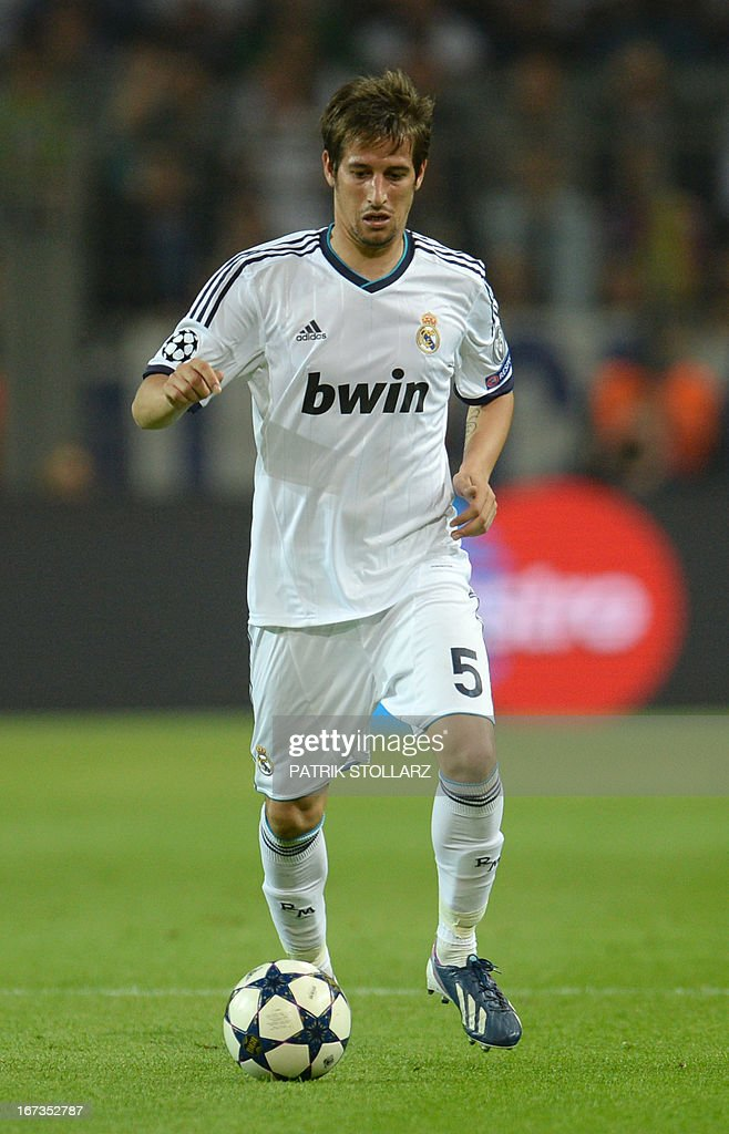 Real Madrid's Portuguese defender Fabio Coentrao runs with the ball during the UEFA Champions League semi final first leg football match between Borussia Dortmund and Real Madrid on April 24, 2013 in Dortmund, western Germany. Dortmund won the match 4-1.