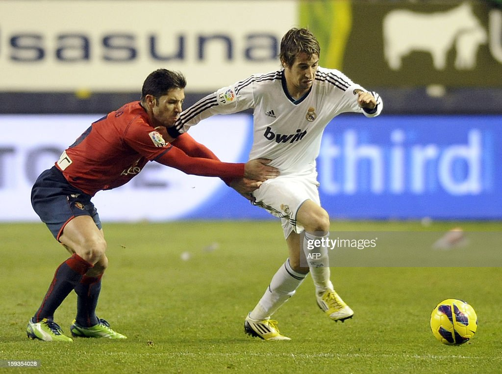 Real Madrid's Portuguese defender Fabio Coentrao (R) vies with Osasuna's midfielder Alvaro Cejudo (L) during the Spanish league football match CA Osasuna vs Real Madrid CF at the Reyno de Navarra stadium in Pamplona on January 12, 2013. AFP PHOTO / ANDER GILLENEA