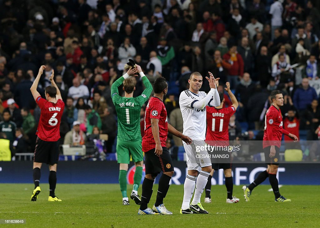 Real Madrid's Portuguese defender Pepe (C-R) and Manchester United's players applaud their supporters at the end of the UEFA Champions League round of 16 first leg football match Real Madrid CF vs Manchester United FC at the Santiago Bernabeu stadium in Madrid on February 13, 2013. The match ended in a 1-1 draw