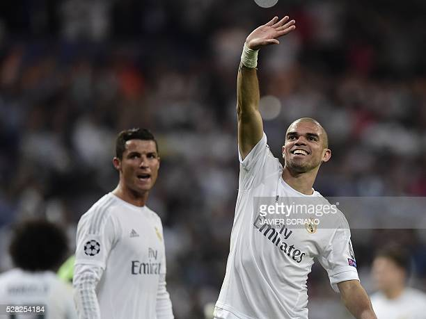 Real Madrid's Portuguese defender Pepe and Real Madrid's Portuguese forward Cristiano Ronaldo celebrate at the end the UEFA Champions League...