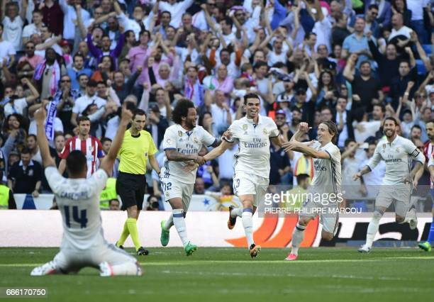 Real Madrid's Portuguese defender Pepe celebrates scoring a goal with teammates during the Spanish league football match Real Madrid CF vs Club...