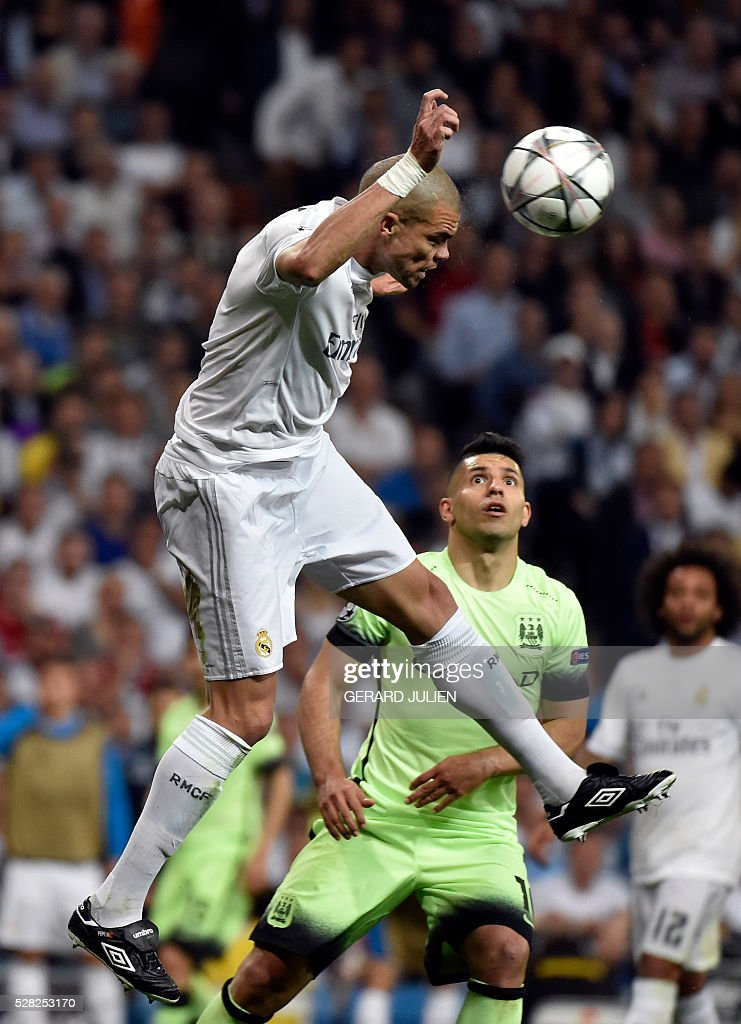 Real Madrid's Portuguese defender Pepe (L) heads the ball past Manchester City's Argentinian forward Sergio Aguero during the UEFA Champions League semi-final second leg football match Real Madrid CF vs Manchester City FC at the Santiago Bernabeu stadium in Madrid, on May 4, 2016. / AFP / GERARD
