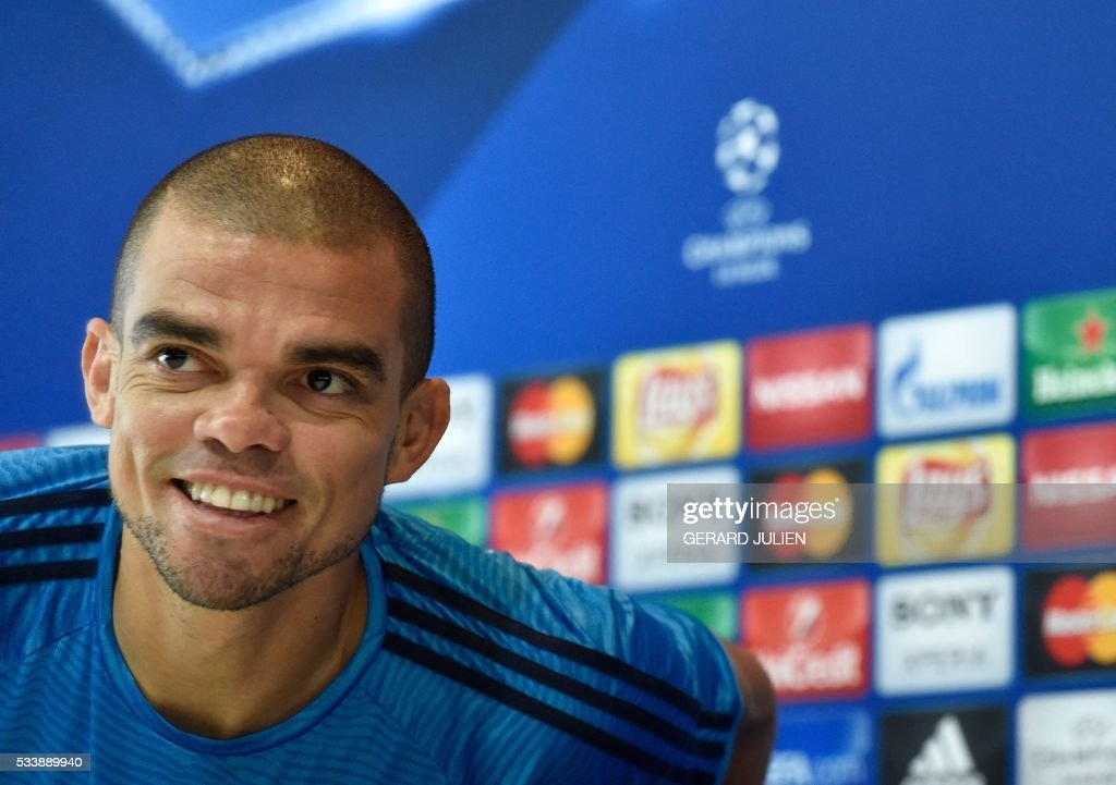 Real Madrid's Portuguese defender Pepe leaves after giving a press conference at the club's Open Media Day at Real Madrid sport city in Madrid on May 24, 2016. / AFP / GERARD