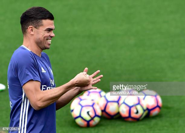 Real Madrid's Portuguese defender Pepe smiles during a training session at Valdebebas training ground in Madrid on May 5 on the eve of the Spanish...