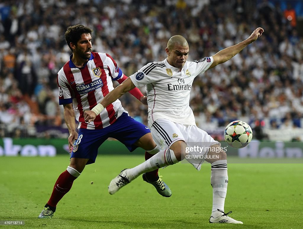 Real Madrid's Portuguese defender <a gi-track='captionPersonalityLinkClicked' href=/galleries/search?phrase=Pepe+-+Portuguese+Soccer+Player&family=editorial&specificpeople=4401229 ng-click='$event.stopPropagation()'>Pepe</a> (R) vies with Atletico Madrid's midfielder Raul Garcia during the UEFA Champions League quarter-finals second leg football match Real Madrid CF vs Club Atletico de Madrid at the Santiago Bernabeu stadium in Madrid on April 22, 2015.