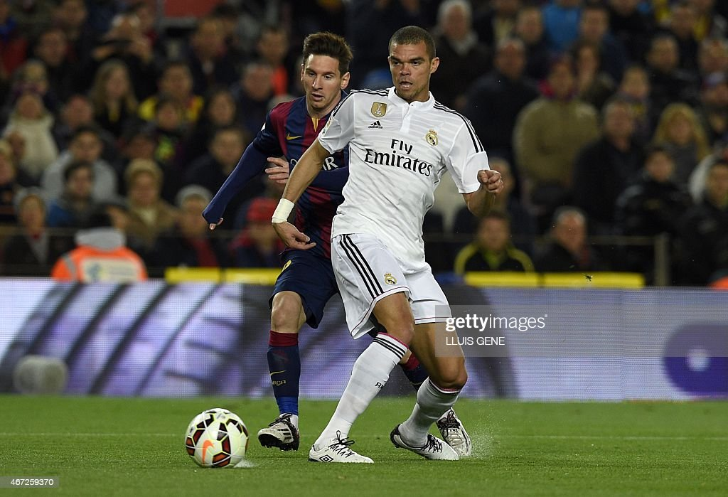 Real Madrid's Portuguese defender <a gi-track='captionPersonalityLinkClicked' href=/galleries/search?phrase=Pepe+-+Portuguese+Soccer+Player&family=editorial&specificpeople=4401229 ng-click='$event.stopPropagation()'>Pepe</a> (R) vies with Barcelona's Argentinian forward <a gi-track='captionPersonalityLinkClicked' href=/galleries/search?phrase=Lionel+Messi&family=editorial&specificpeople=453305 ng-click='$event.stopPropagation()'>Lionel Messi</a> (L) during the 'clasico' Spanish league football match FC Barcelona vs Real Madrid CF at the Camp Nou stadium in Barcelona on March 22, 2015.
