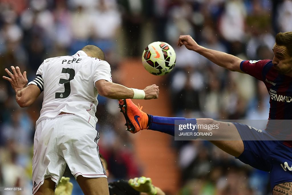 Real Madrid's Portuguese defender <a gi-track='captionPersonalityLinkClicked' href=/galleries/search?phrase=Pepe+-+Portuguese+Soccer+Player&family=editorial&specificpeople=4401229 ng-click='$event.stopPropagation()'>Pepe</a> (L) vies with Eibar's midfielder Borja during the Spanish league football match Real Madrid CF vs SD Eibar at the Santiago Bernabeu stadium in Madrid on April 11, 2015.