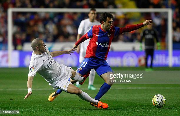 Real Madrid's Portuguese defender Pepe vies with Levante's Italian forward Giuseppe Rossi during the Spanish league football match Levante UD vs Real...