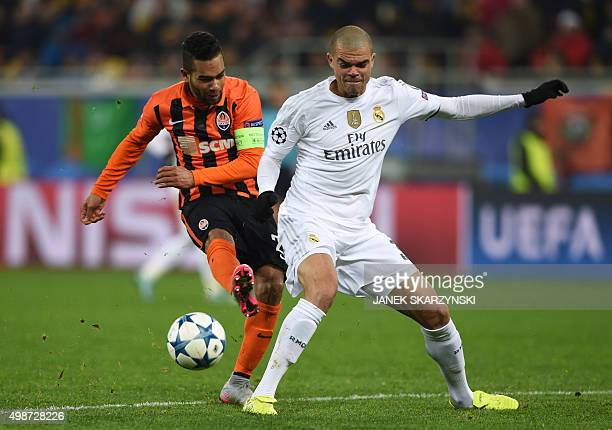 Real Madrid's Portuguese defender Pepe vies with Shakhtar Donetsk's Brazilian midfielder Alex Teixeira during the UEFA Champions League group A...
