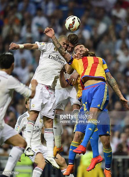 Real Madrid's Portuguese defender Pepe vies with Valencia's Argentinian defender Nicolas Otamendi during the Spanish league football match Real...