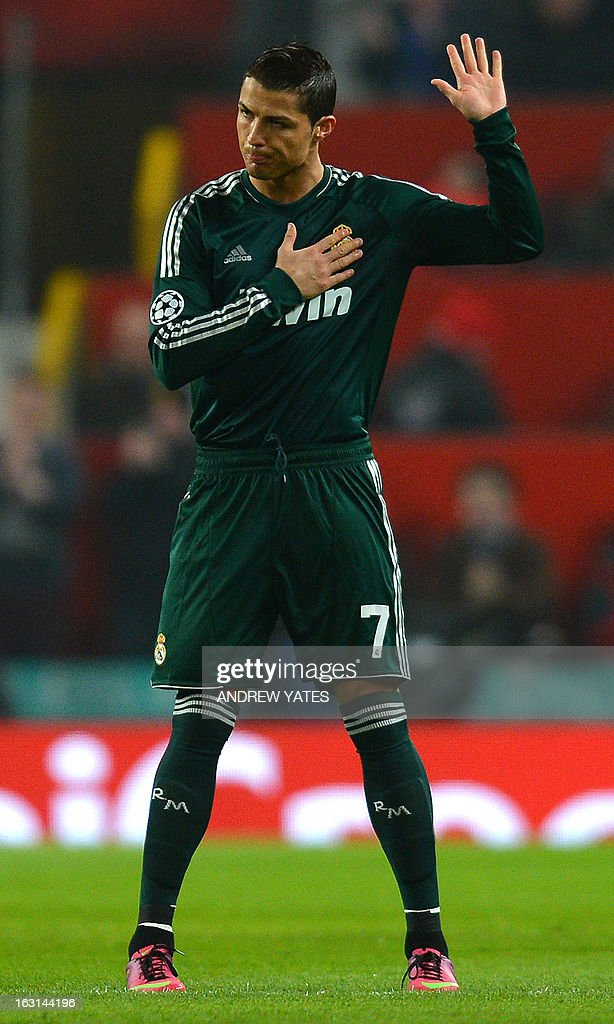 Real Madrid's Portuguese forward Cristiano Ronaldo acknowledges the crowd during the UEFA Champions League round of 16 second leg football match between Manchester United and Real Madrid at Old Trafford in Manchester, northwest England, on March 5, 2013. AFP PHOTO / ANDREW YATES