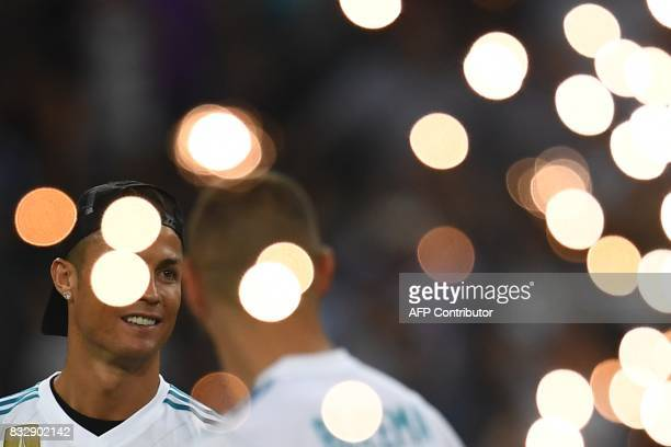 Real Madrid's Portuguese forward Cristiano Ronaldo and a teammate celebrate their Supercup after winning the second leg of the Spanish Supercup...