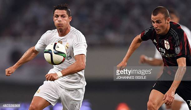 Real Madrid's Portuguese forward Cristiano Ronaldo and AC Milan's Italian defender Luca Antonelli vie for the ball during the International Champions...