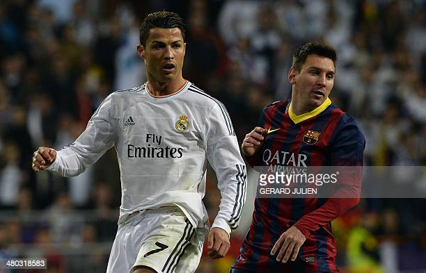 Real Madrid's Portuguese forward Cristiano Ronaldo and Barcelona's Argentinian forward Lionel Messi look on during the Spanish league 'Clasico'...