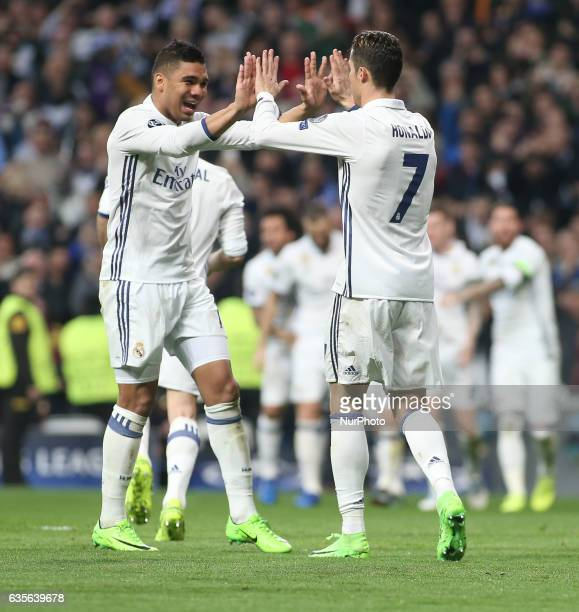Real Madrid's Portuguese forward Cristiano Ronaldo and Casimiro celebrate their third goal during the UEFA Champions League round of 16 first leg...