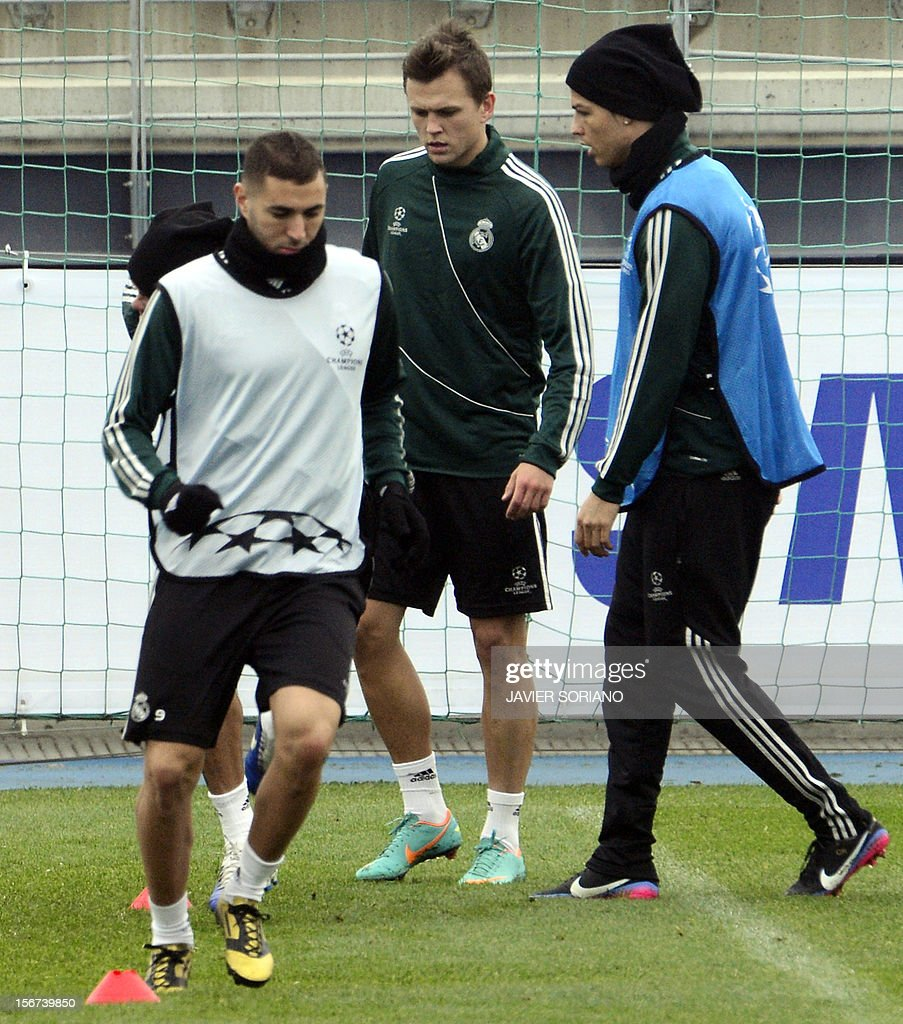 Real Madrid's Portuguese forward Cristiano Ronaldo (R) and Real Madrid's French forward Karim Benzema (L) take part in a training session at the Real Madrid Sport City in Madrid on November 20, 2012 on the eve of a UEFA Champions League football match against Manchester City.