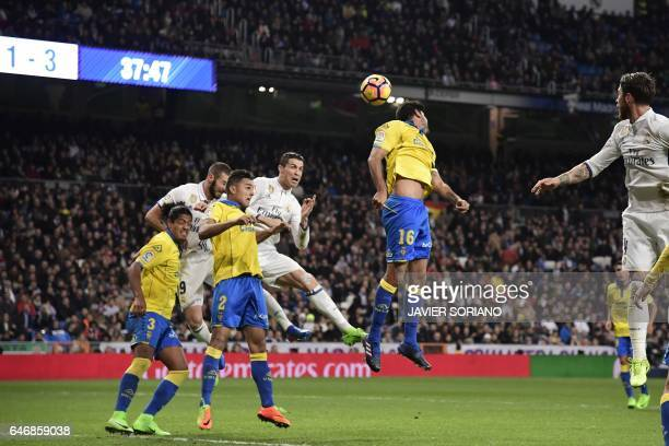 Real Madrid's Portuguese forward Cristiano Ronaldo and Real Madrid's French forward Karim Benzema vie with Las Palmas' defender David Simon Las...