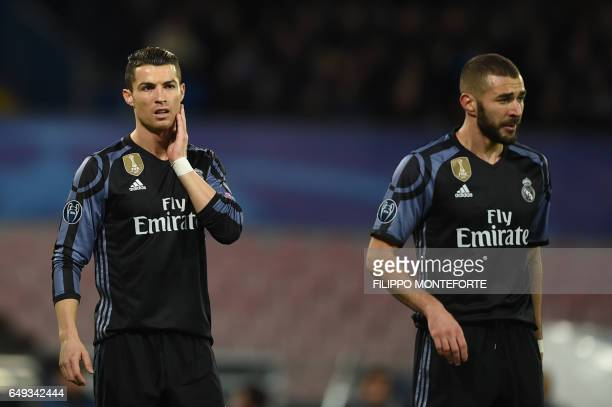 Real Madrid's Portuguese forward Cristiano Ronaldo and Real Madrid's French forward Karim Benzema look on during the UEFA Champions League football...