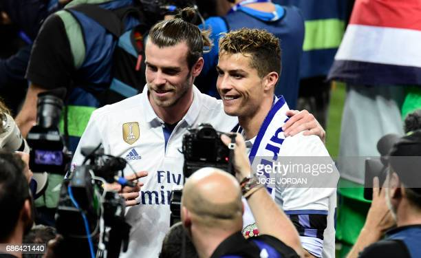 Real Madrid's Portuguese forward Cristiano Ronaldo and Real Madrid's Welsh forward Gareth Bale pose after winning the Liga title after the Spanish...