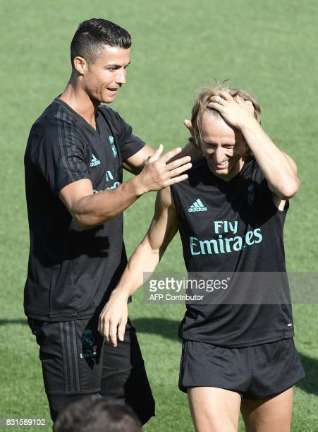 Real Madrid's Portuguese forward Cristiano Ronaldo and Real Madrid's Croatian midfielder Luka Modric take part in a training session at Real Madrid...