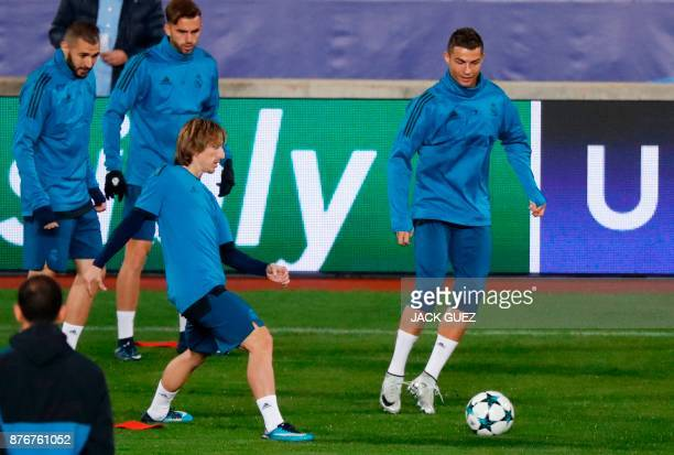 Real Madrid's Portuguese forward Cristiano Ronaldo and Real Madrid's Croatian midfielder Luka Modric take part in a training session in the Cypriot...