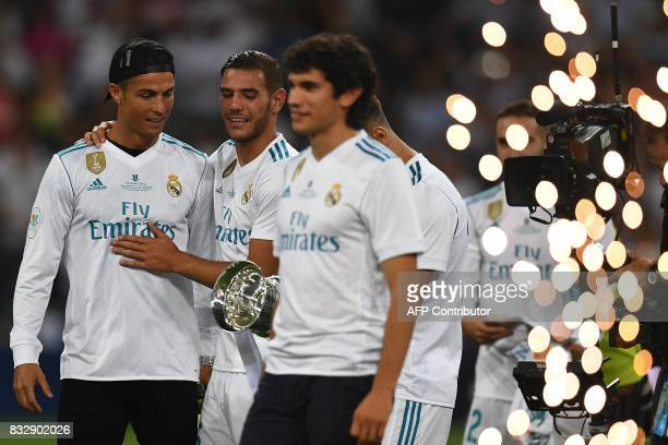 Real Madrid's Portuguese forward Cristiano Ronaldo and teammates celebrate their Supercup after winning the second leg of the Spanish Supercup...
