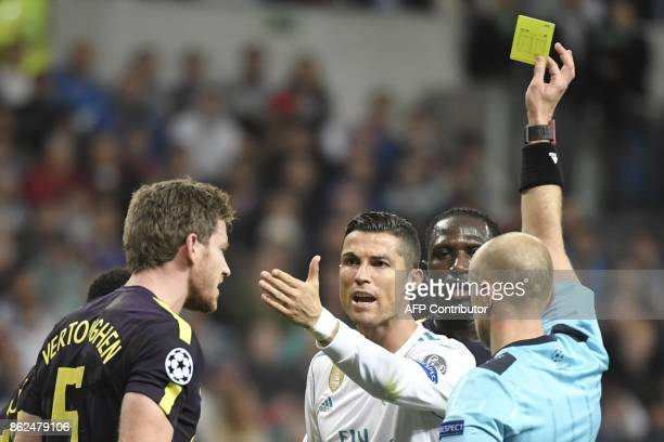 Real Madrid's Portuguese forward Cristiano Ronaldo argues with Tottenham Hotspur's Belgian defender Jan Vertonghen during the UEFA Champions League...