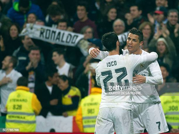TOPSHOT Real Madrid's Portuguese forward Cristiano Ronaldo celebrates a goal with teammate Real Madrid's midfielder Isco during the Spanish league...