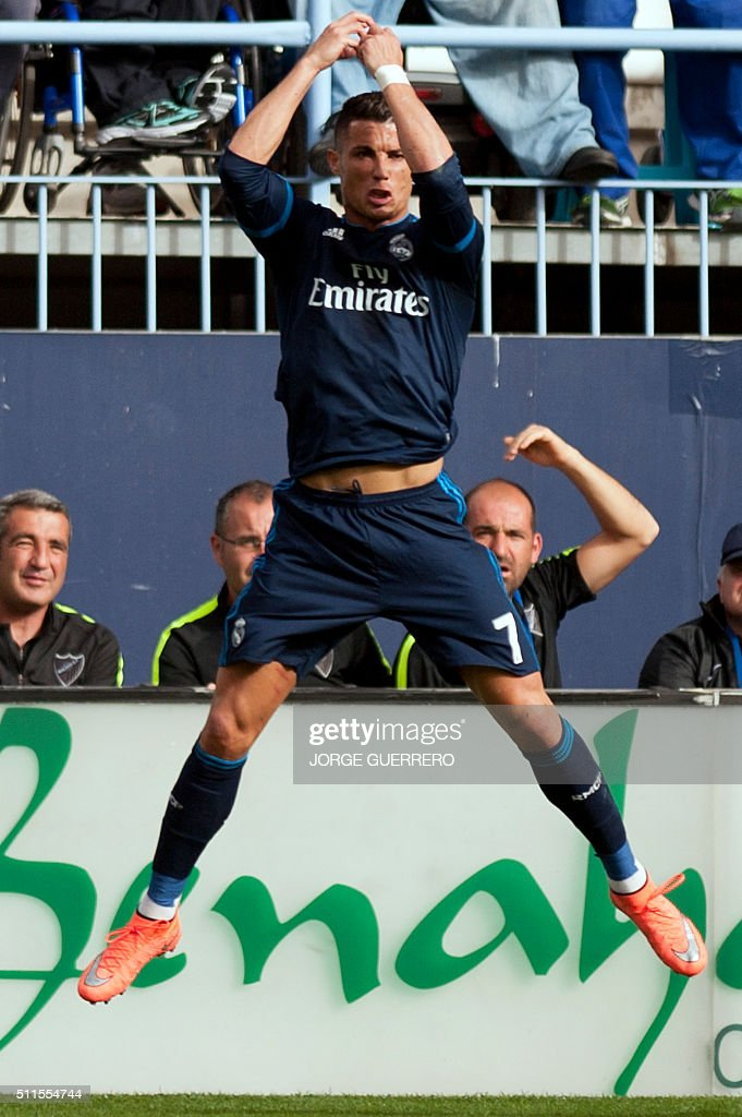 Real Madrid's Portuguese forward Cristiano Ronaldo celebrates a goal during the Spanish league football match Malaga CF vs Real Madrid CF at La...