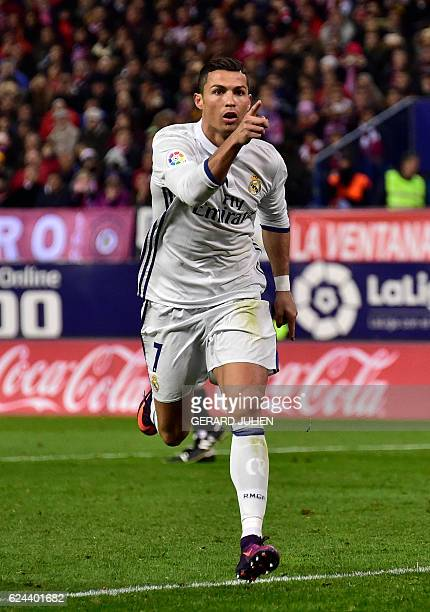 TOPSHOT Real Madrid's Portuguese forward Cristiano Ronaldo celebrates a goal during the Spanish league football match between Club Atletico de Madrid...