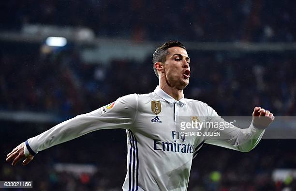 Real Madrid's Portuguese forward Cristiano Ronaldo celebrates a goal during the Spanish league football match Real Madrid CF vs Real Sociedad at the...