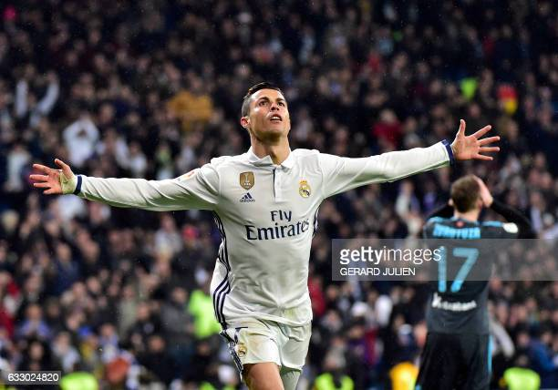 TOPSHOT Real Madrid's Portuguese forward Cristiano Ronaldo celebrates a goal during the Spanish league football match Real Madrid CF vs Real Sociedad...
