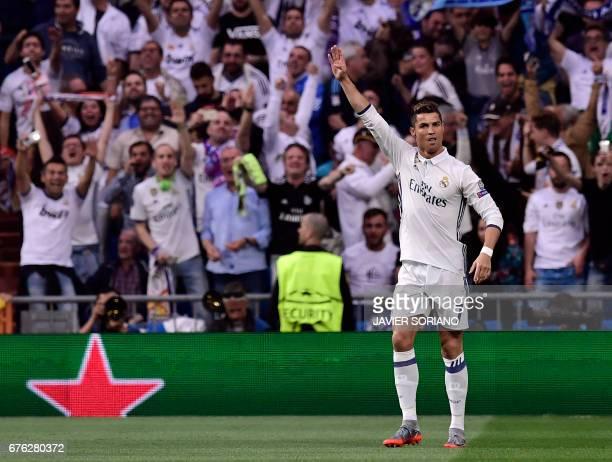 Real Madrid's Portuguese forward Cristiano Ronaldo celebrates a goal during the UEFA Champions League semifinal first leg football match Real Madrid...
