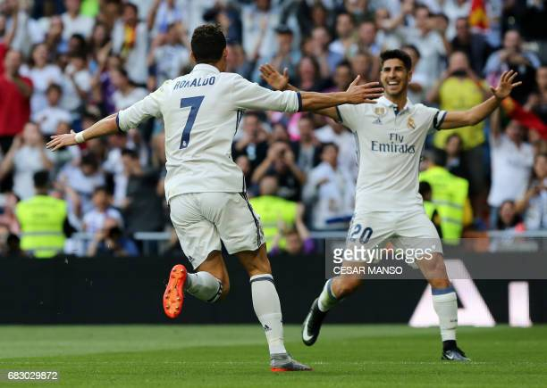 Real Madrid's Portuguese forward Cristiano Ronaldo celebrates a goal with Real Madrid's midfielder Marco Asensio during the Spanish league football...