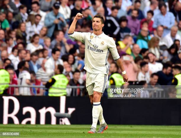 Real Madrid's Portuguese forward Cristiano Ronaldo celebrates a goal during the Spanish league football match Real Madrid CF vs Sevilla FC at the...