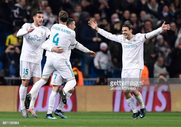 Real Madrid's Portuguese forward Cristiano Ronaldo celebrates a goal with teammates during the UEFA Champions League group H football match Real...