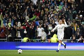Real Madrid's Portuguese forward Cristiano Ronaldo celebrates after scoring a goal during the Champions League quarterfinal second leg football match...